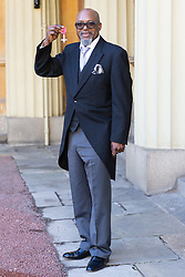 ROTA:  Musician and composer Orphy Robinson proudly display his MBE awarded for services to music at an investiture at Buckingham Palace in London. London, November 13 2018.