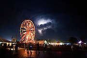 MANCHESTER, TN - JUNE 11:  Lighting lights the sky behind the ferris wheel after a thunderstorm on Thursday night at the 2009 Bonnaroo Music and Arts Festival on June 11, 2009 in Manchester, Tennessee. Photo by Bryan Rinnert/3Sight Photography