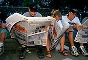 Students mourn their friends killed aboard TWA Airlines Flight 800 as they read news reports of the tragedy July 18, 1996 in Montoursville, PA. TWA Flight 800 exploded off East Moriches, NY with the loss of 230 lives including 21 students from the town.