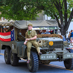 Lititz, PA / USA - July 3, 2017:   Military vehicles on parade in a small American town in observance of the 4th of July Independence Day celebration.