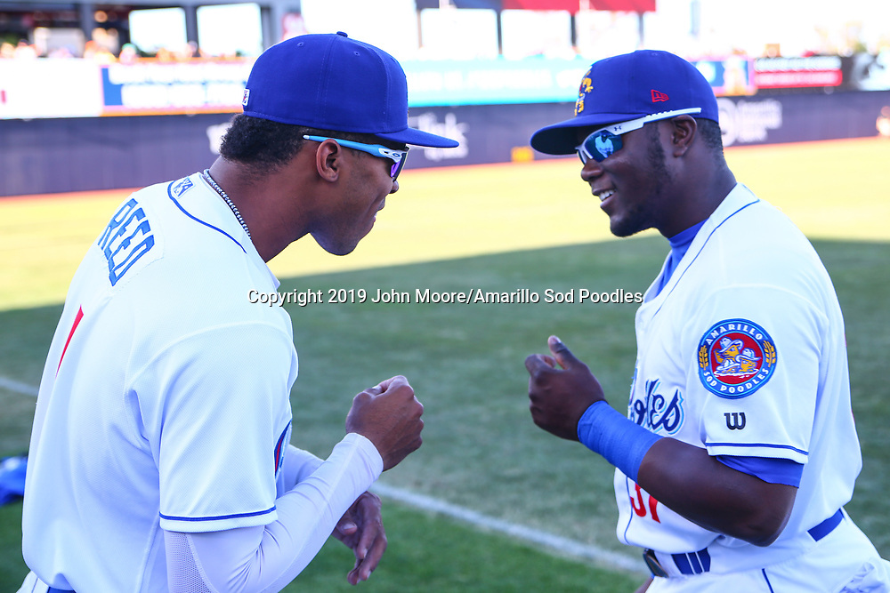Amarillo Sod Poodles outfielders Buddy Reed (1) and Jorge Ona (31) before the game against the Corpus Christi Hooks on Saturday, April 20, 2019, at HODGETOWN in Amarillo, Texas. [Photo by John Moore/Amarillo Sod Poodles]