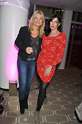 Left to right, GABY ROSLIN and RONNI ANCONA at a private view of photographs by Joanna Vestey entitled 'Dreams For My Daughter' in aid of The White Ribbon Alliance, held at The Royal Festival Hall, South Bank, London on 8th March 2012.