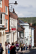 Scene along the High Street in East Sussex's famous town of Lewes. Lewes is the county town of East Sussex, England, a civil parish and is the centre of the Lewes local government district. The settlement has a history as a bridging point and as a market town, and today as a communications hub and tourist-orientated town. At the 2001 census it had a population of 15,988