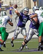 Kansas State quarterback Dylan Meier (9) fires the ball down field under pressure from Marshall defenders, at Bill Snyder Family Stadium in Manhattan, Kansas, September 16, 2006.  The Wildcats beat the Thundering Herd 23-7.