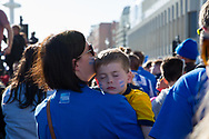 Young fan falls asleep during the Brighton & Hove Albion Football Club Promotion Parade at Brighton Seafront, Brighton, East Sussex. United Kingdom on 14 May 2017. Photo by Ellie Hoad.