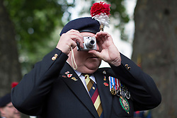 © licensed to London News Pictures. London, UK 15/10/2013. 400 veterans from 2nd Battalion the Royal Regiment of Fusiliers getting ready to march through Whitehall in London to protest against the Battalion being disbanded as part of the Army 2020 defence review. Photo credit: Tolga Akmen/LNP