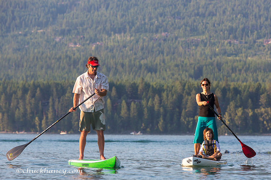 Family with standup paddle boards at Whitefish Lake State Park, Montana, USA model released