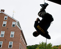 Sergeant Rich Simmons of the Belknap Regional Special Operations Team practices rappelling techniques during the Child Safety Day program at Laconia Rotary Park on Sunday afternoon.  (Karen Bobotas/for the Laconia Daily Sun)