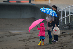 © London News Pictures. 26/03/2016 Aberystwyth, Wales, UK. In a foretaste of Storm Katie, strong winds and driving rain make life unpleasant for people out on the promenade in Aberystwyth on the Saturday of the Easter bank holiday weekend. Photo credit: Keith Morris/LNP