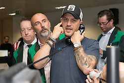 © Licensed to London News Pictures. 11/09/2018. London, UK.  Tom Hardy at the 14th Annual BGC Charity Day held on the trading floor of BGC Partners in Canary Wharf, to raise money for charitable causes in commemoration of BGC's 658 colleagues and the 61 Eurobrokers employees lost on 9/11.  Photo credit: Vickie Flores/LNP