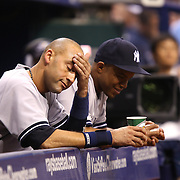New York Yankees shortstop Derek Jeter (2) is seen wiping his head in the Yankees dugout during a major league baseball game between the New York Yankees and the Tampa Bay Rays at Tropicana Field on Thursday, Sept. 17, 2014 in St. Petersburg, Florida. The Yankees won the game 3-2 and this was Jeter's last game against Tampa Bay. (AP Photo/Alex Menendez)