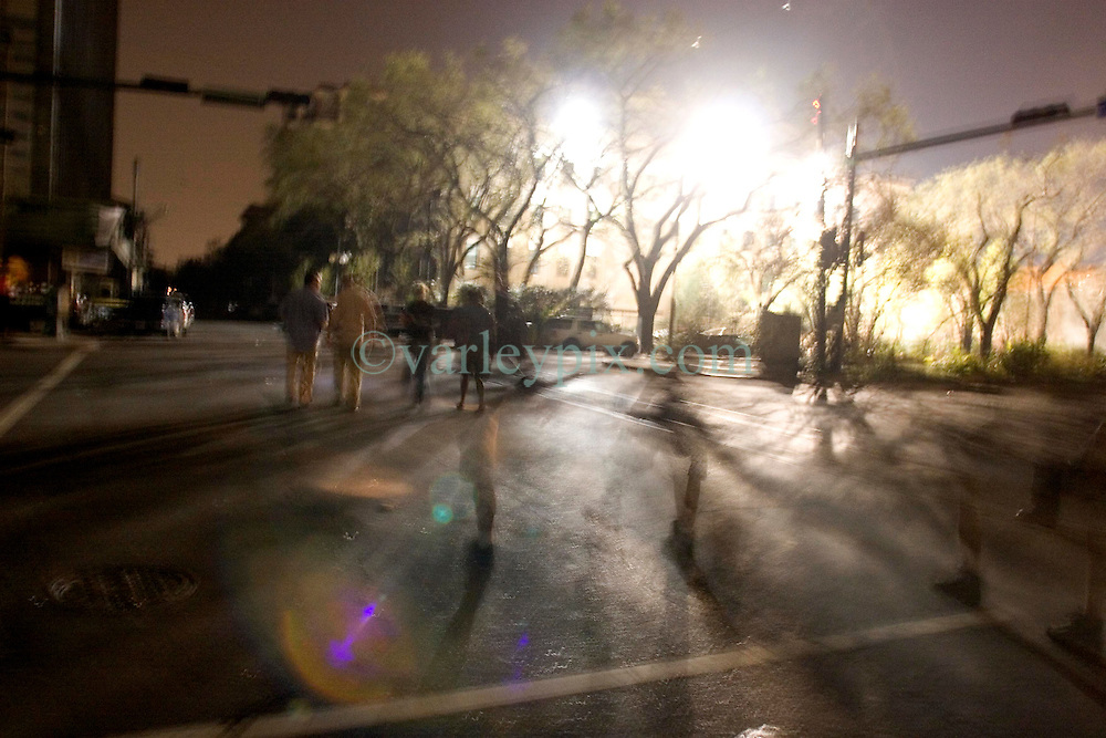 10 Sept 2005. New Orleans,Louisiana. Hurricane Katrina aftermath.<br /> Journalists walk back to the Best Western after curfew in the city.<br /> Photo; ©Charlie Varley/varleypix.com