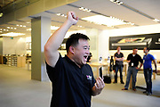 One of the first customers to get a new iphone 4 at the Apple store in central London.