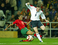 Phto: Scott Heavey.<br /> Portugal v England. International Friendly. 18/02/2004.<br /> Wayne Rooney skips over the challenge from Jorge Andrade.