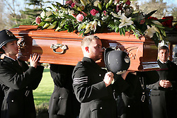 **NOTE: People in police uniform are not real policemen** © Licensed to London News Pictures. 09/12/2015. London, UK. The coffin being carried in to the crematorium by men dressed as policemen... The funeral of former brothel keeper Cynthia Payne takes place at the South London Crematorium.  In 1980 Cynthia Payne was sentenced to 18 months for running a brothel at her house on Ambleside Avenue in Streatham. It was alleged, at the time, that judges and Members of Parliament were visitors to her establishment. Photo credit: Peter Macdiarmid/LNP