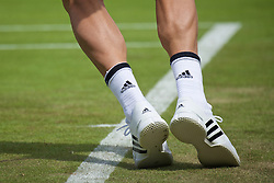 LONDON, ENGLAND - Tuesday, June 28, 2016: The Adidas tennis shoes and socks of Tomas Berdych (CZE) during the Gentlemen's Singles 1st Round match on day two of the Wimbledon Lawn Tennis Championships at the All England Lawn Tennis and Croquet Club. (Pic by Kirsten Holst/Propaganda)