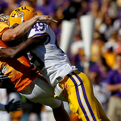 Oct 2, 2010; Baton Rouge, LA, USA; LSU Tigers defensive end Barkevious Mingo (49) hits Tennessee Volunteers quarterback Matt Simms (2) forcing a fumble during the first half at Tiger Stadium.  Mandatory Credit: Derick E. Hingle