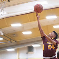 Tohatchi Cougar Titus Norton (24) drives to the basket for a layup against the Rehoboth Lynx Tuesday night in Rehoboth. Rehoboth defeated Tohatchi 64-40.