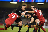 Dan Carter of New Zealand is stopped by Georgia's Giorgi Begadze (9) and Lasha Malaquradze (10). Rugby World Cup 2015 pool c match, New Zealand v Georgia at the Millennium Stadium in Cardiff, South Wales  on Friday 2nd October 2015.<br /> pic by  Andrew Orchard, Andrew Orchard sports photography.