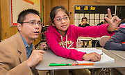 Pang-Cheng Liu works on math problems with students at McNamara Elementary School, December 4, 2014.