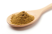 ground Cumin (Cuminum cyminum) on a wooden kitchen spoon on white Background