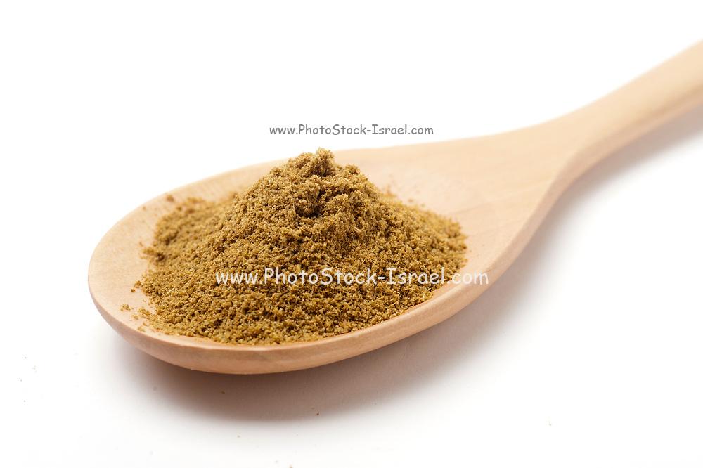 ground Cumin (Cuminum cyminum) on a wooden kitchen spoon on white Background