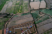 Aerial view of a tourist hotel and rice paddies, south of Siem Reap, Cambodia.