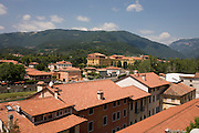 North Italian town of Bassano del Grappa with Dolomite foothills in the distance.