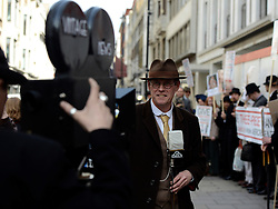 © Licensed to London News Pictures. 23/04/2012. London, UK . A 'vintage news' team report from the scene. A protest organised today, 23rd April 2012, by Chap Magazine and the Tailors of Savile Row to petition against the proposed opening of a new Abercrombie and Fitch Store on Savile Row. The protesters gathered to sing 'Give 3 Piece A Chance' outside the present store on Burlington Gardens. Photo credit : Stephen Simpson/LNP