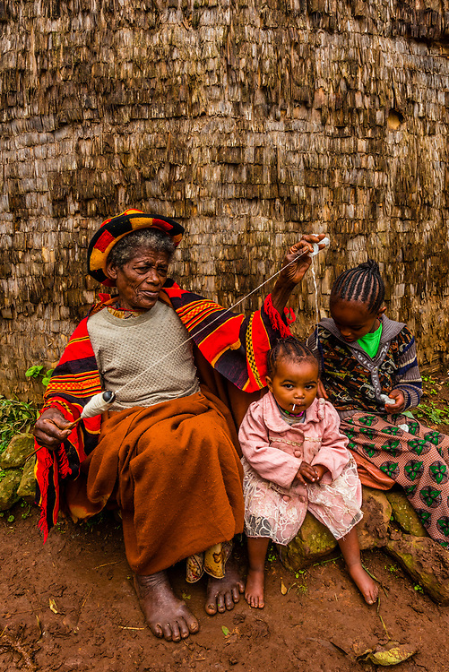 A woman spinning thread in a Dorze village, Southern Nations Nationalities and People's Region, Ethiopia. The Dorze people are famous for their weaving skills.