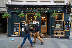 Edinburgh, Scotland, UK. 14 November 2020. Views of Edinburgh city centre on Saturday afternoon during a level 3 lockdown imposed by the Scottish Government;.Pictured; The Albanach pub on Royal Mile is open for takeaway service. Iain Masterton/Alamy Live News.