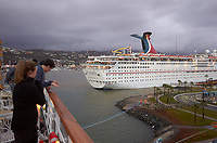 """(Image one of nine) Panorama of the Ensenada harbor in Mexico on a grey and raining day from the deck of the MV World Odyssey. The other cruse ship is the Carnival Imagination. Once all of the students, faculty, staff, and life long learners were aboard we would be ready to begin the 102 day """"round the world"""" Semester at Sea Spring 2016 Voyage. Composite of nine images taken with a Leica T camera and 23 mm f/2 lens (ISO 250, 23 mm, f/2, 1/80 sec). Panorama stitched using AutoPano Giga Pro."""