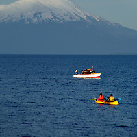 South America, Chile, Puerto Varas. Boats on Llanquihue Lake with the Osorno Volcano, Puerto Varas.