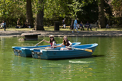© Licensed to London News Pictures. 22/07/2014. London, UK. Two young women  enjoying paddle boating in the sunshine in St Regents Park in central London this lunchtime. Photo credit : Vickie Flores/LNP