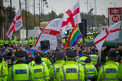 © Licensed to London News Pictures . 12/10/2013 . Bradford , UK . The EDL hold a demonstration in Bradford today (Saturday 12th October 2013) . It is their first demonstration since leaders Stephen Yaxley-Lennon (aka Tommy Robinson ) and Kevin Carroll quit . Approximately 500 protesters gathered near the city centre . Photo credit : Joel Goodman/LNP