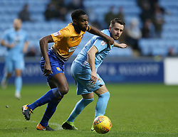 Coventry City's Marc McNulty (right) and Mansfield Town's Hayden White battle for the ball