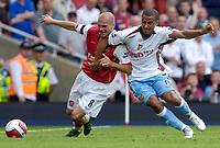 Photo: Daniel Hambury.<br />Arsenal v Aston Villa. The Barclays Premiership. 19/08/2006.<br />Arsenal's Fredrik Ljungberg and Villa's Gabriel Agbonlahor battle.