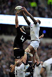 Brodie Retallick (New Zealand) and Courtney Lawes (England) compete for lineout ball - Photo mandatory by-line: Patrick Khachfe/JMP - Tel: Mobile: 07966 386802 16/11/2013 - SPORT - RUGBY UNION -  Twickenham Stadium, London - England v New Zealand - QBE Autumn Internationals.