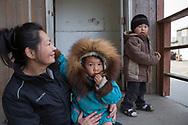 Andrea Kuzuguk Herrington tillsammans med hennes tvillingar, Dolores och Jeremiah. Shishmaref. Alaska, USA<br /> <br /> Fotograf: Christina Sjögren<br /> <br /> Photographer: Christina Sjogren<br /> Copyright 2018, All Rights Reserved