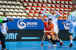 The Dutch handball player Jorn Smits in action against Borut Mackovsek, Matej Gaber from Slovenia during the European Championship qualifying match on January 6, 2020 in Topsportcentrum Almere