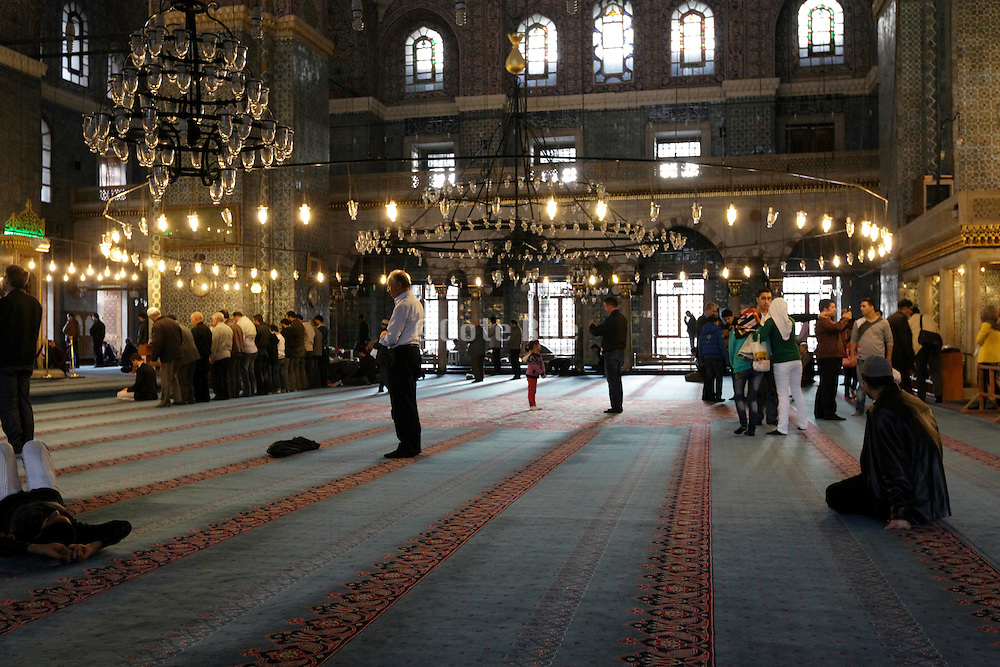 men praying in the Yeni (New) Mosque in Istanbul