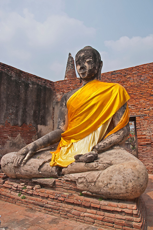 A buddha statue within the grounds of ancient Ayutthaya city, Thailand.