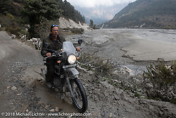 Round the World Doug Wothke on day-5  of our Himalayan Heroes adventure riding from Kalopani through the Mustang District to our highest elevation of the trip at over 12,000' when we reached Muktinath, Nepal. Saturday, November 10, 2018. Photography ©2018 Michael Lichter.