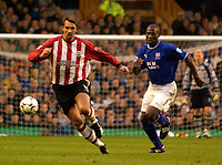 Photo. Jed Wee.<br /> Everton v Southampton, FA Barclaycard Premiership, Goodison Park, Liverpool. 19/10/03.<br /> Southampton's Claus Lundekvam (L) in action against Everton's Kevin Campbell.