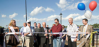 Miss Weirs Beach Megan Lyman, Executive Councilor Raymond Burton, Councilor Armand Bolduc, Councilor Greg Knytych, Laconia Public Works Director Paul Moynihan and Mayor Michael Seymour officially cut the ribbon to reopen the Weirs Boardwalk on Thursday afternoon.  (Karen Bobotas/for the Laconia Daily Sun)