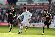 Ki Sung-Yueng of Swansea city © looks to go past Oscar of Chelsea. Premier league match, Swansea city v Chelsea at the Liberty Stadium in Swansea, South Wales on Sunday 11th Sept 2016.<br /> pic by  Andrew Orchard, Andrew Orchard sports photography.