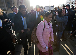 © Licensed to London News Pictures. 04/01/2012. London, UK.  SUBHASH BIDVE and YOGINI BIDVE the parents of murdered indian student ANUJ BIDVE leaving the Houses of Parliament London on January 4th, 2012 after arriving in the UK from Mumbai. The Family of 20 year-old ANUJ BIDVE, are expected to travel to Manchester to visit the scene where ANUJ was shot dead.  Photo credit: Ben Cawthra/LNP