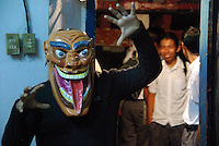 """MEXICO, Veracruz, Tantoyuca, Oct 27- Nov 4, 2009. A traditional wooden mask in the Tantoyuca dance studio of Marcelo Rodriguez Ordaz. """"Xantolo,"""" the Nahuatl word for """"Santos,"""" or holy, marks a week-long period during which the whole Huasteca region of northern Veracruz state prepares for """"Dia de los Muertos,"""" the Day of the Dead. For children on the nights of October 31st and adults on November 1st, there is costumed dancing in the streets, and a carnival atmosphere, while Mexican families also honor the yearly return of the souls of their relatives at home and in the graveyards, with flower-bedecked altars and the foods their loved ones preferred in life. Photographs for HOY by Jay Dunn."""