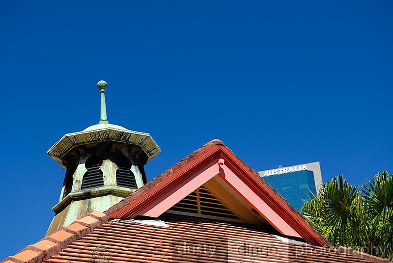 Older building roofs with modern skyscraper in background. Circular Quay, Sydney, Australia