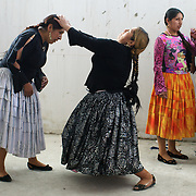 Cholita wrestlers Martha La Altena (left) and Claudina the Condemned practice their moves in the dressingroom before their upcoming bout against each other during the 'Titans of the Ring' wrestling group's Sunday performance at El Alto's Multifunctional Centre. Bolivia. The wrestling group includes the fighting Cholitas, a group of Indigenous Female Lucha Libra wrestlers who fight the men as well as each other for just a few dollars appearance money. El Alto, Bolivia, 14th March 2010. Photo Tim Clayton